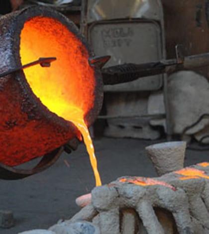Molten-bronze-is-poured-i-001